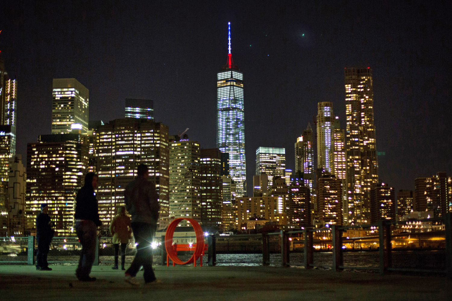 one world trade center spire glows in french colors to honor paris