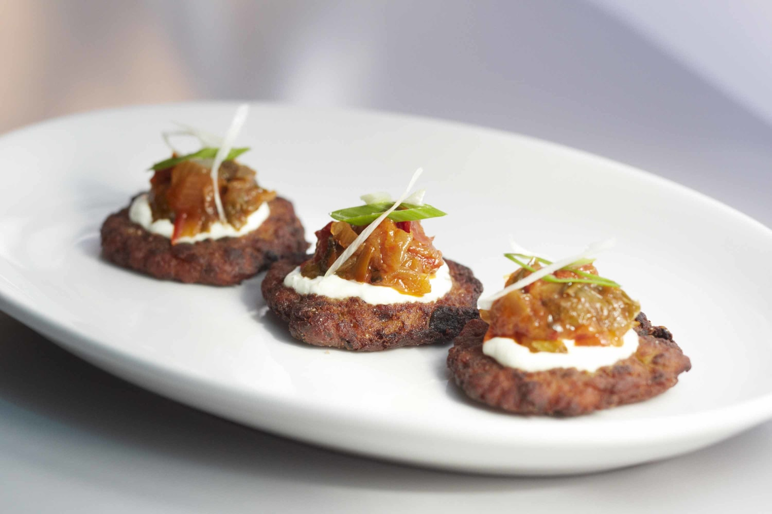 de Calabacín (zucchini fritters with roasted tomato-cumin sauce ...