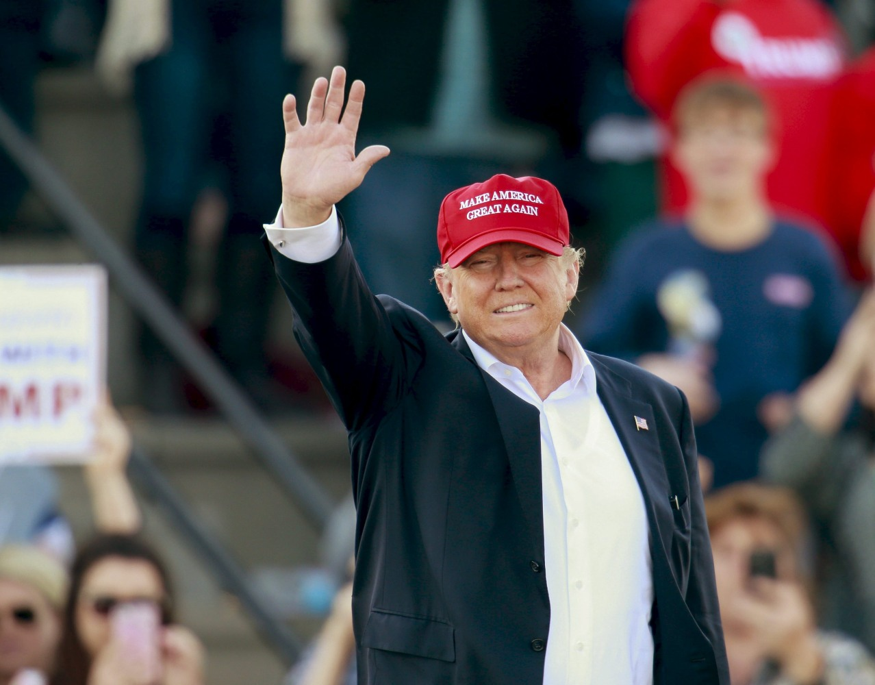 Donald Trump waves to supporters at a rally in Madison, Alabama, on ...