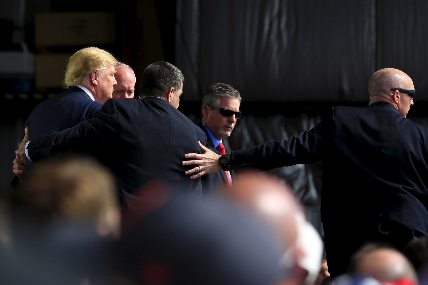 Secret service rushes stage to protect donald trump at ohio rally image secret service agents surround us republican presidential candidate trump during a disturbance as he publicscrutiny Image collections