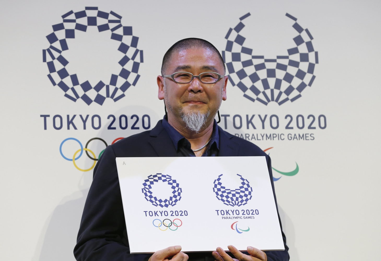 ... 2020 Tokyo Olympics, left, and the 2020 Tokyo Paralympic Games. Shizuo
