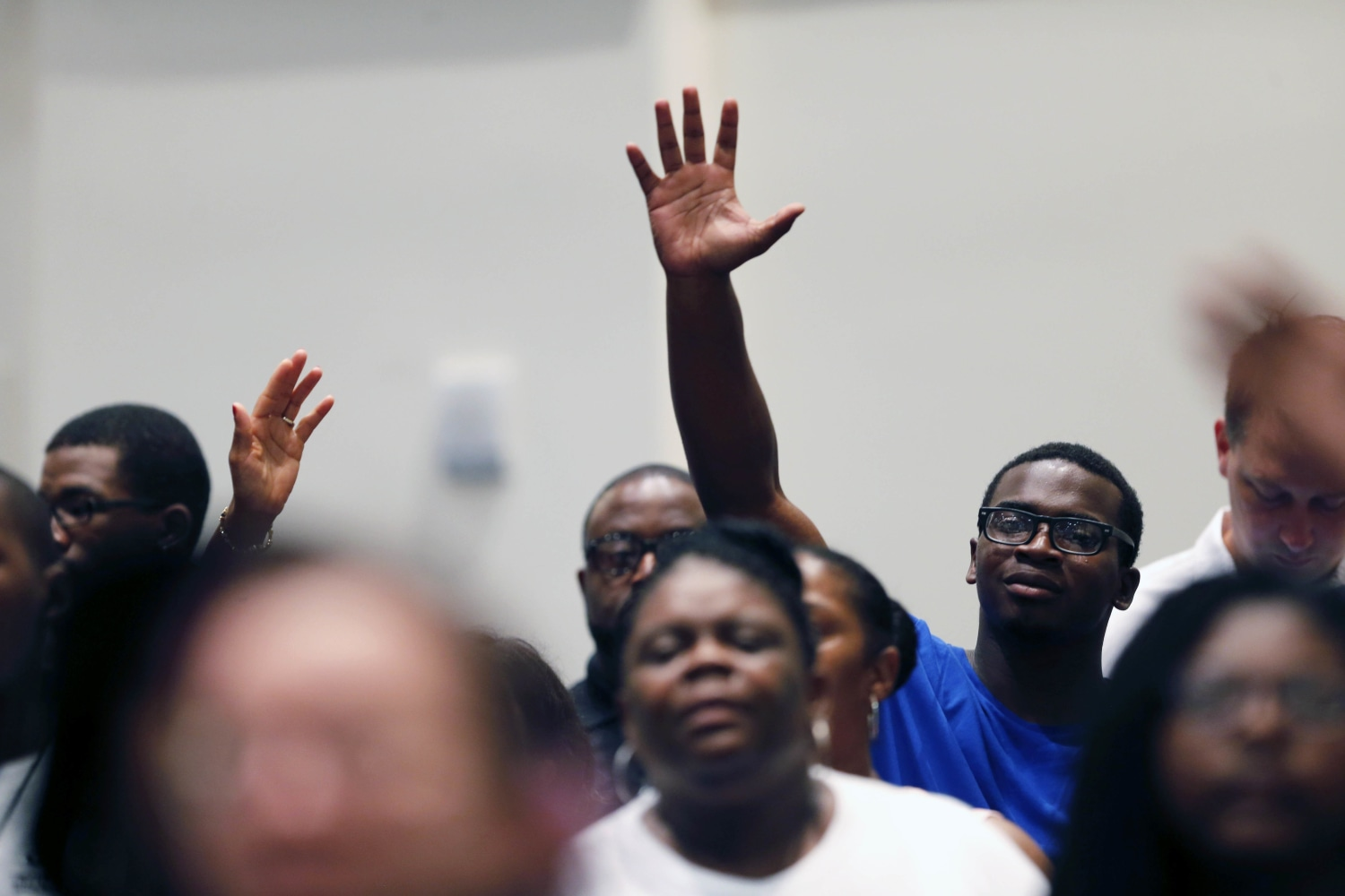 essay faith out works is dead nbc news members of the living faith christian center congregation sing a hymn at a prayer vigil for alton sterling who was shot by baton rouge police in baton