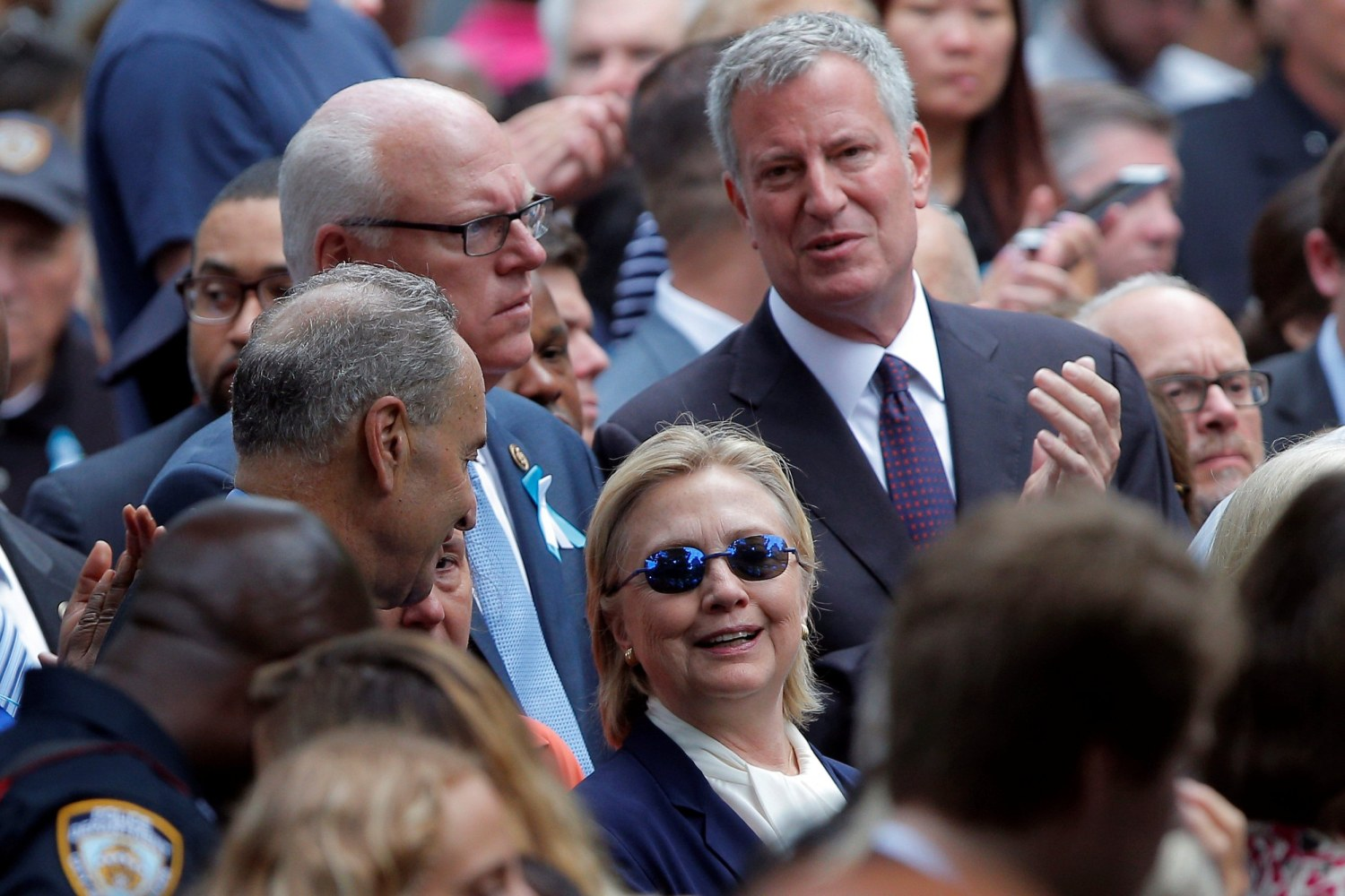 Hillary Clinton leaves 9/11 commemoration early; campaign says she felt 'overheated'