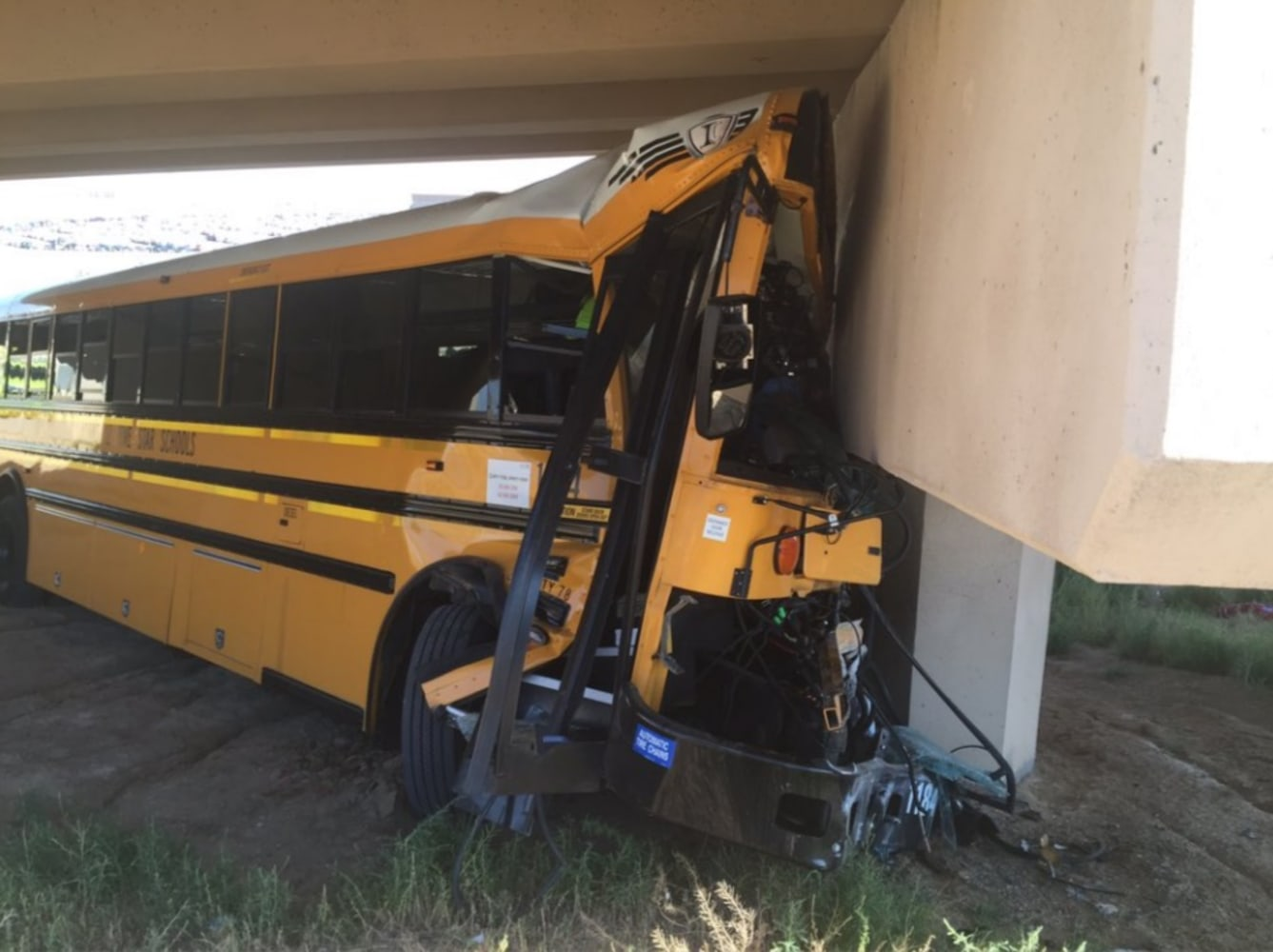 U.S. driver dies, several hurt as school bus carrying football team crashes