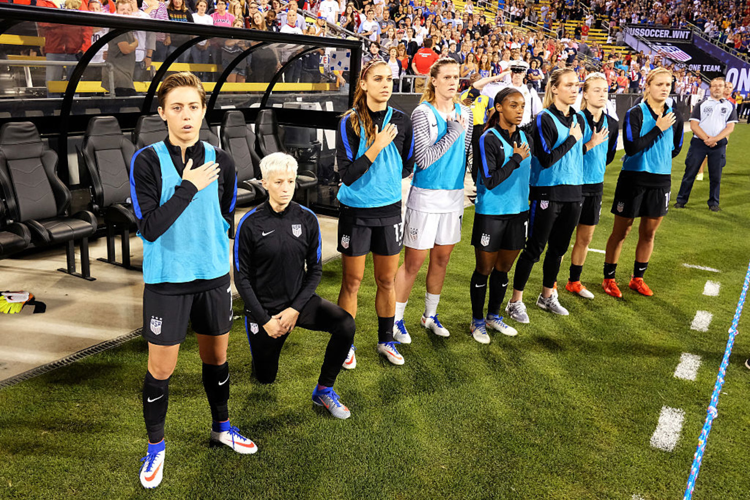news article rapinoe kneels during anthem match thailand