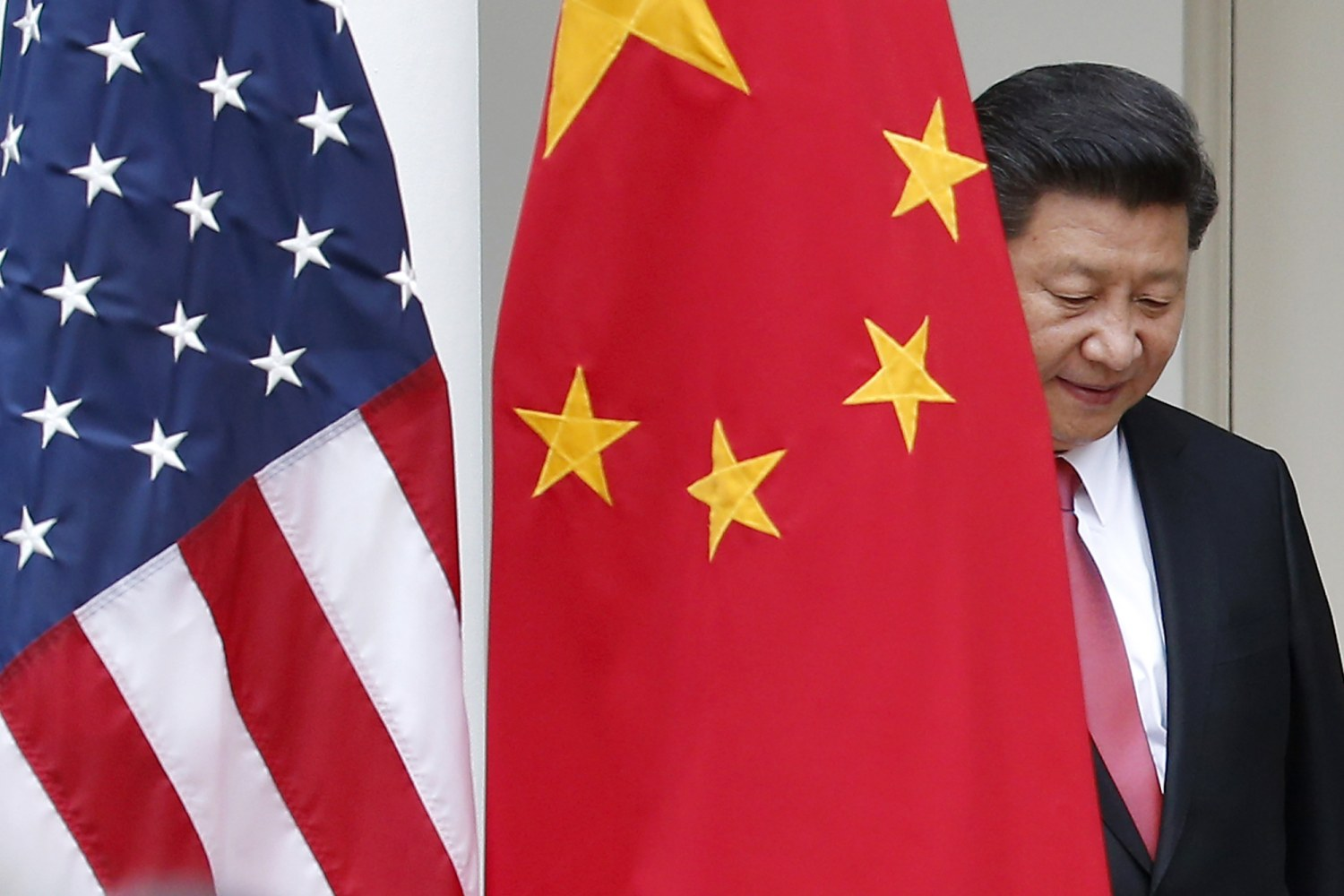 Image chinese president xi jinping steps out from behind china s flag