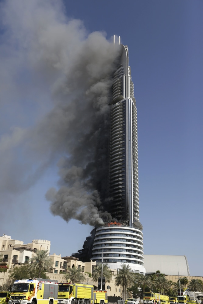 Dubai investigates luxury hotel skyscraper fire near burj Dubai buildings