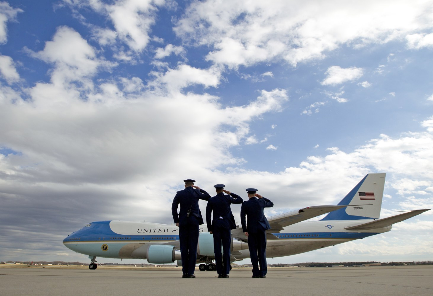 personnel salute as Air Force One, with President Donald Trump ...