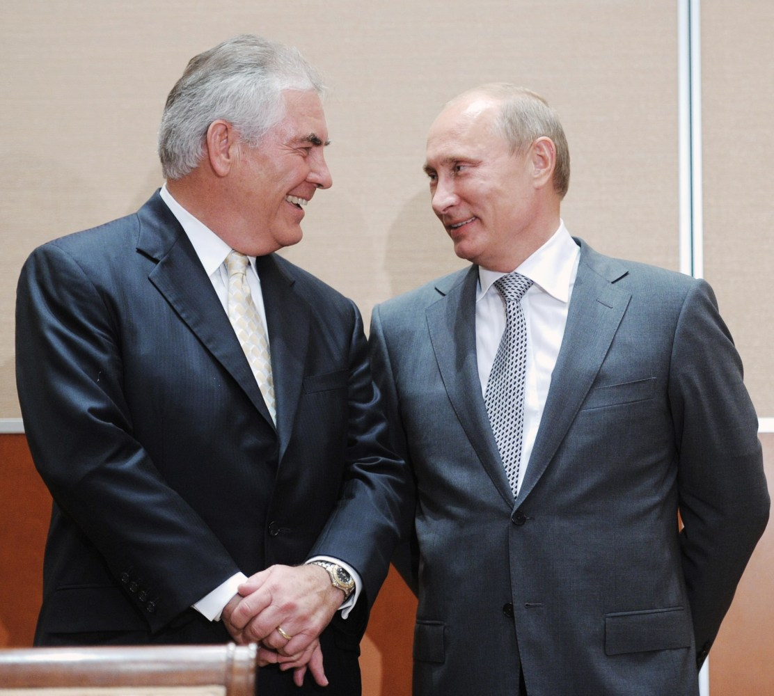 Image Rex Tillerson and Vladimir Putin attend a meeting in August 2011