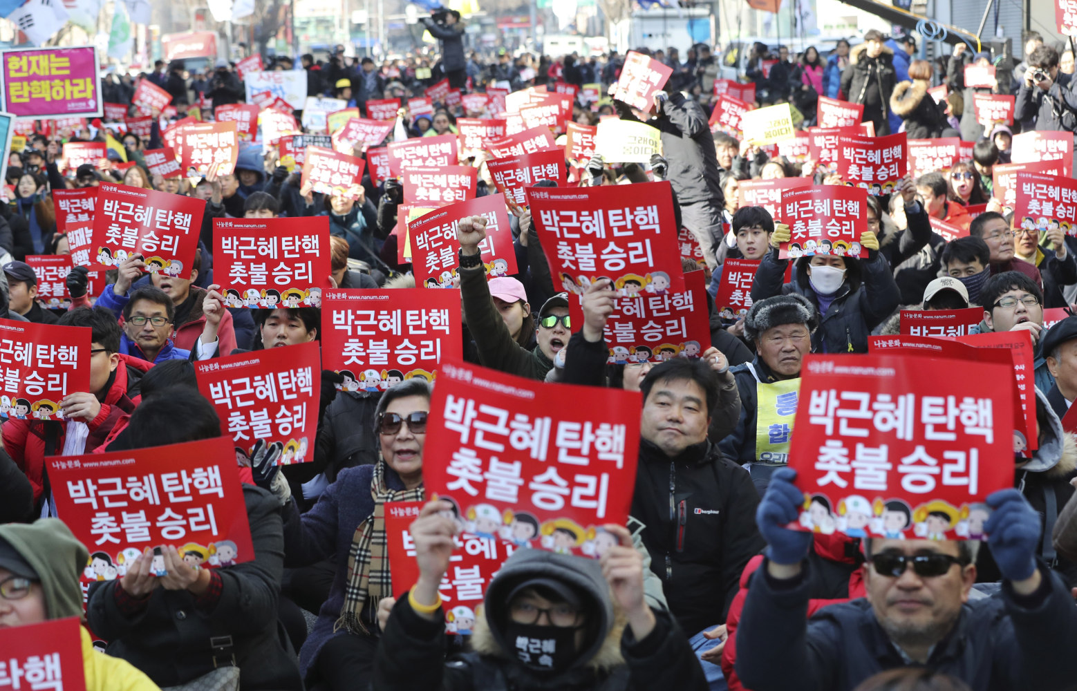 30 injured as thousands celebrate Park Geun-hye's ouster in Seoul
