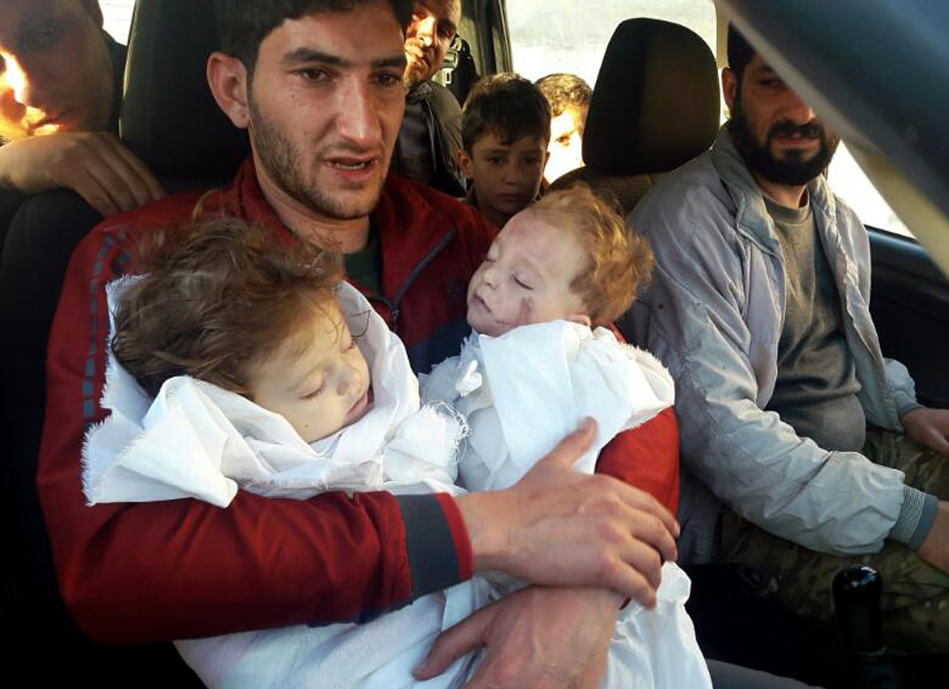 Image result for father holds twin girls, syria, photos