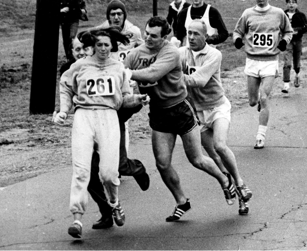 Image result for photo of a woman runner being pushed over in the early years