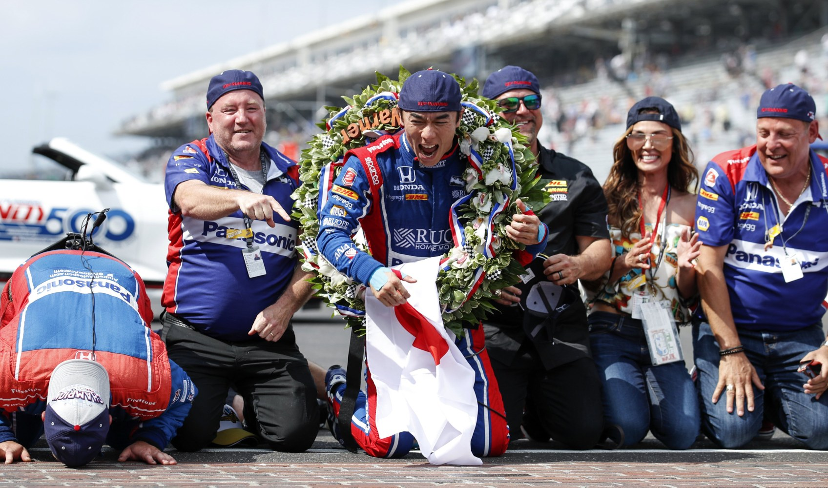 Image Japanese driver Takuma Sato of Andretti Autosport celebrates with his team after winning the 101st running of the Indianapolis 500 auto race at the Indianapolis Motor Speedway in Indianapolis Indiana