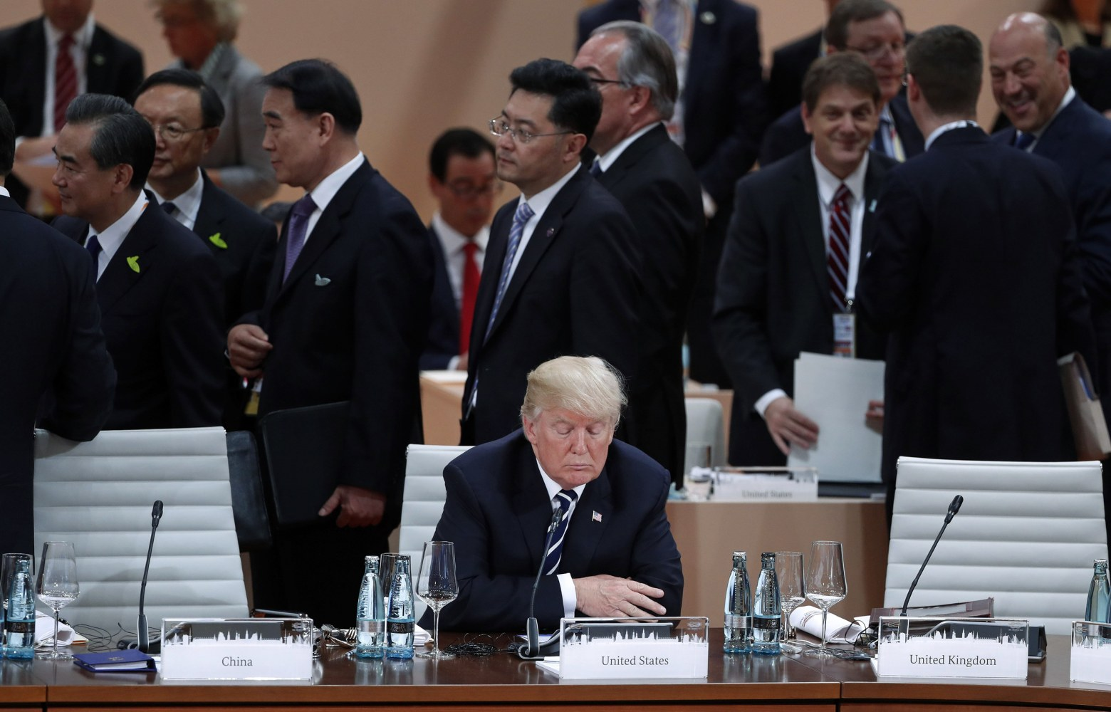 Image result for trump alone at G20