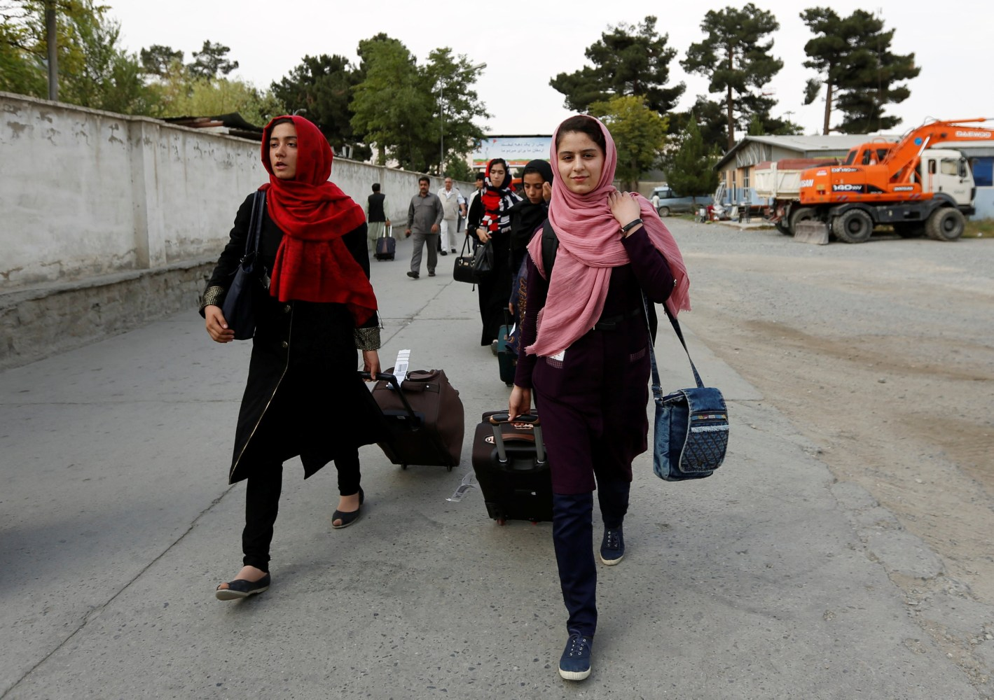 Image Members of Afghan robotics girls team arrive to receive their visas from the U.S. embassy in Kabul