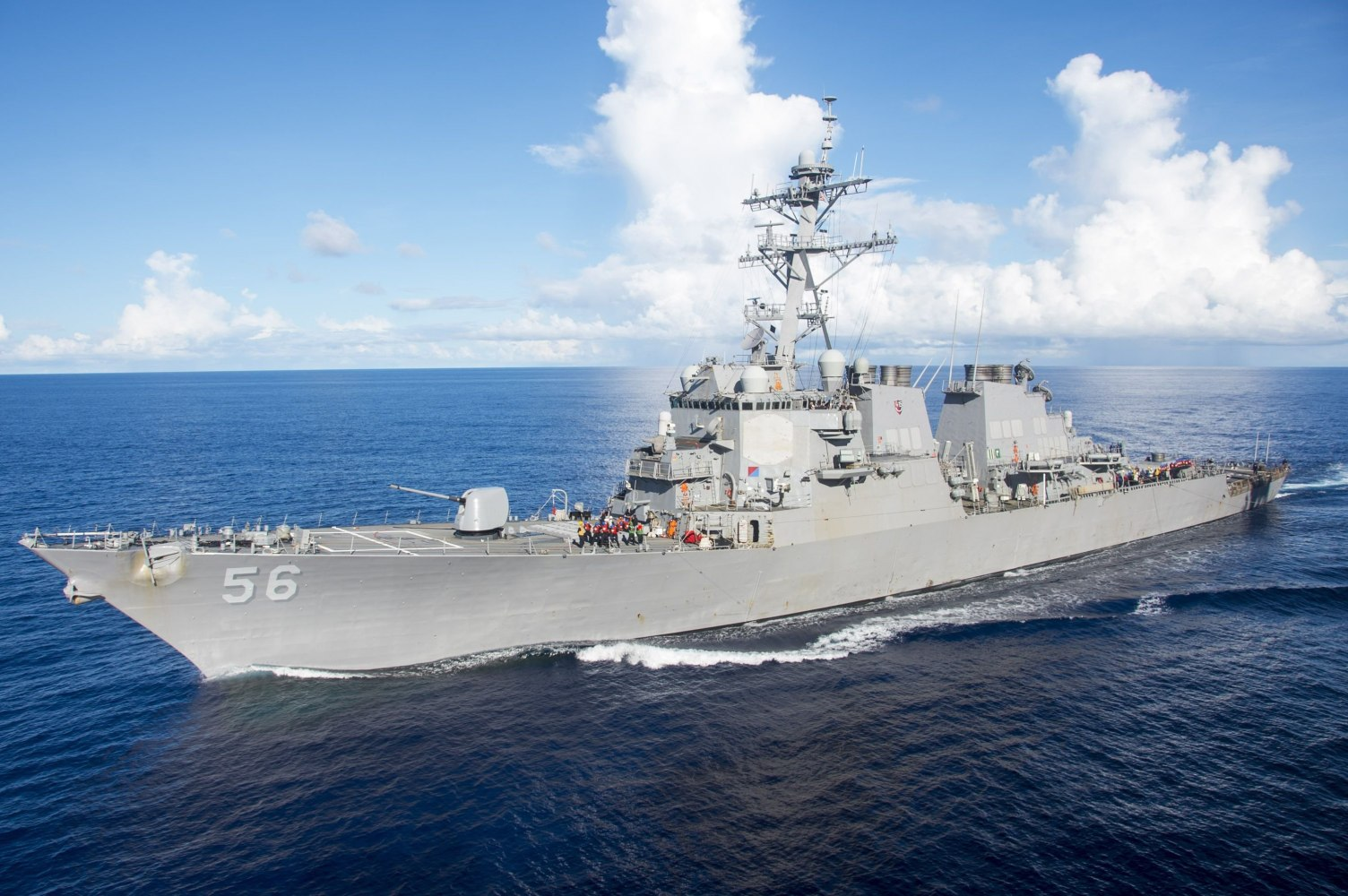 Divers search flooded parts of damaged United States  warship for 10 missing sailors