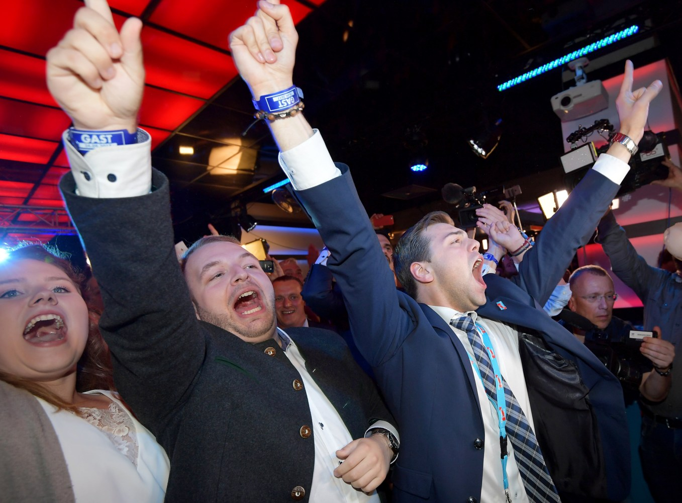Image Supporters of the the German right-wing populist party 'Alternative for Germany&#x27  react upon the first prognosis where right-wing populist party AfD holds their election event in Berlin Germany Sept. 24 2017