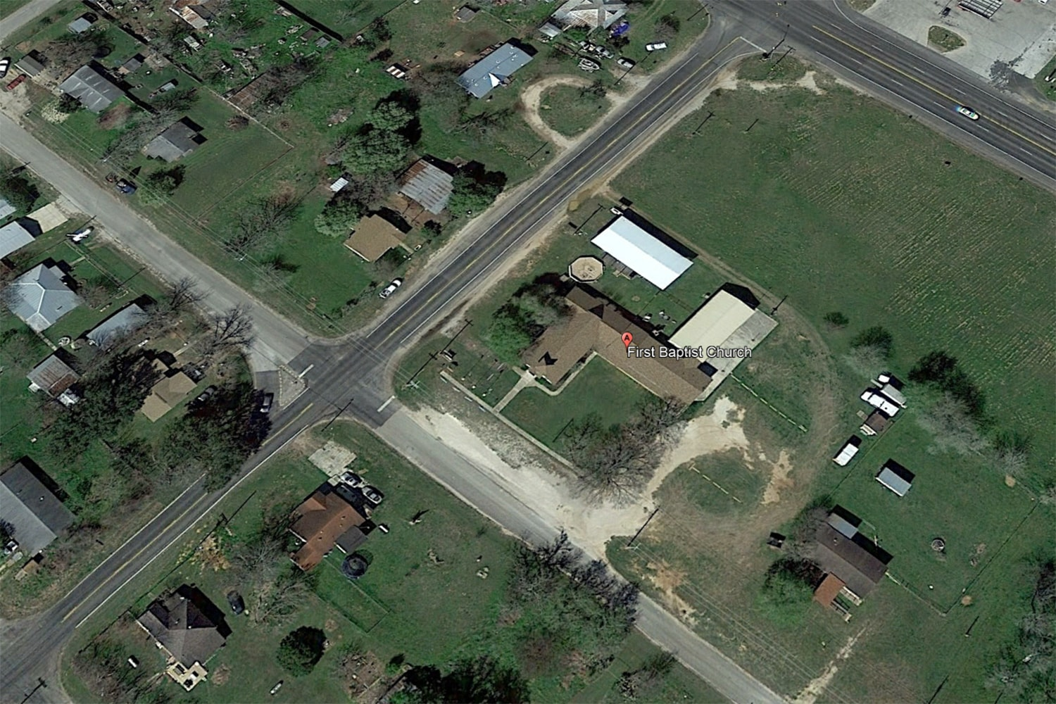 Image A Google Earth satellite view of First Baptist Church in Sutherland Springs Texas
