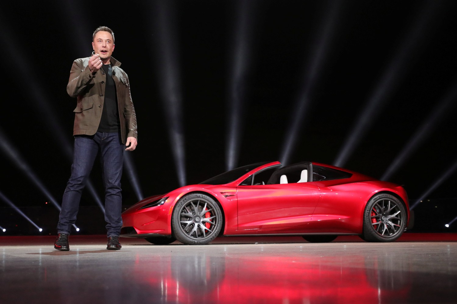 Image Tesla CEO Elon Musk unveils the Roadster 2 during a presentation in Hawthorne California