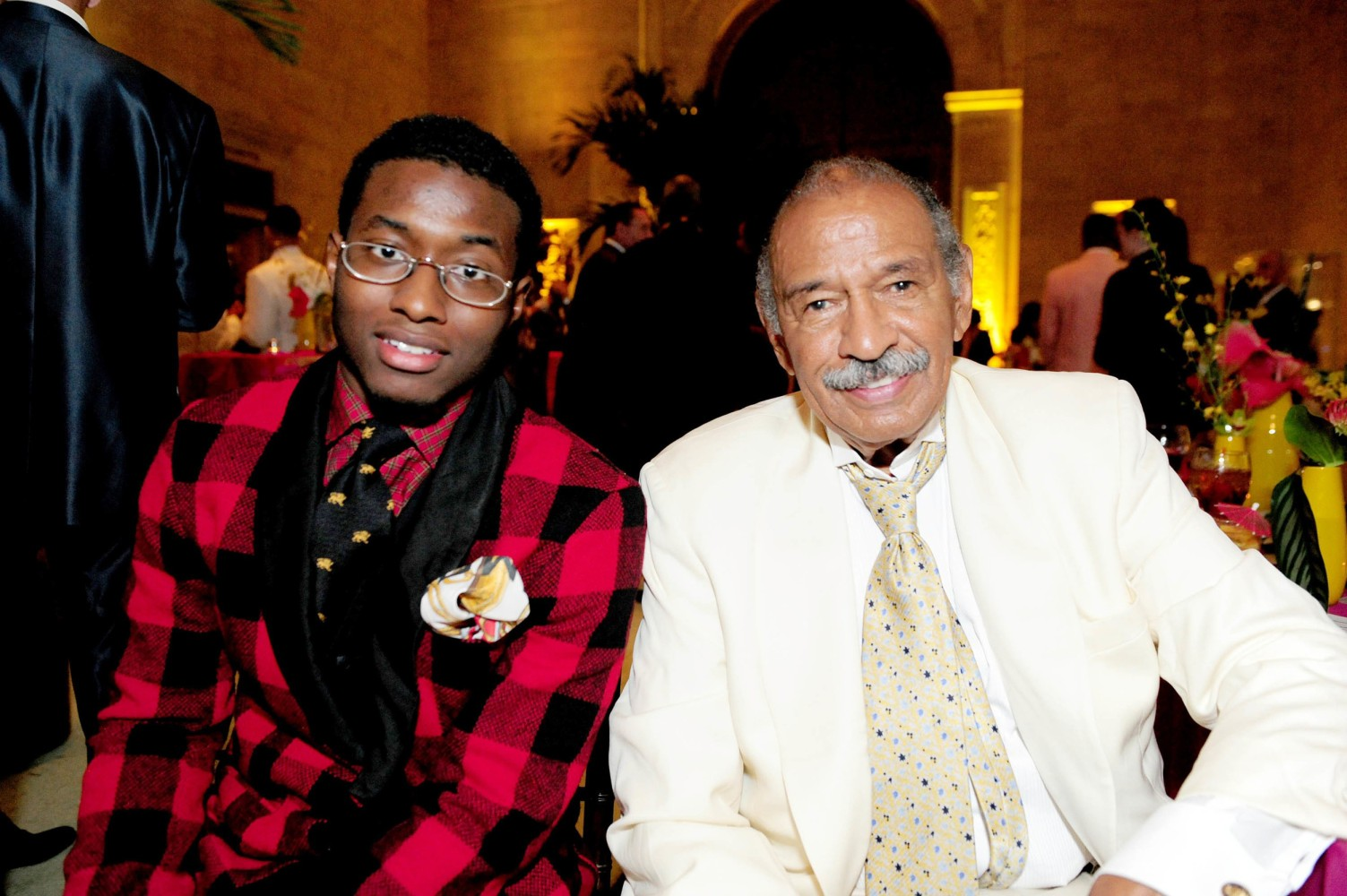 John Conyers III poses with his father Rep. John Conyers Jr. in Detroit