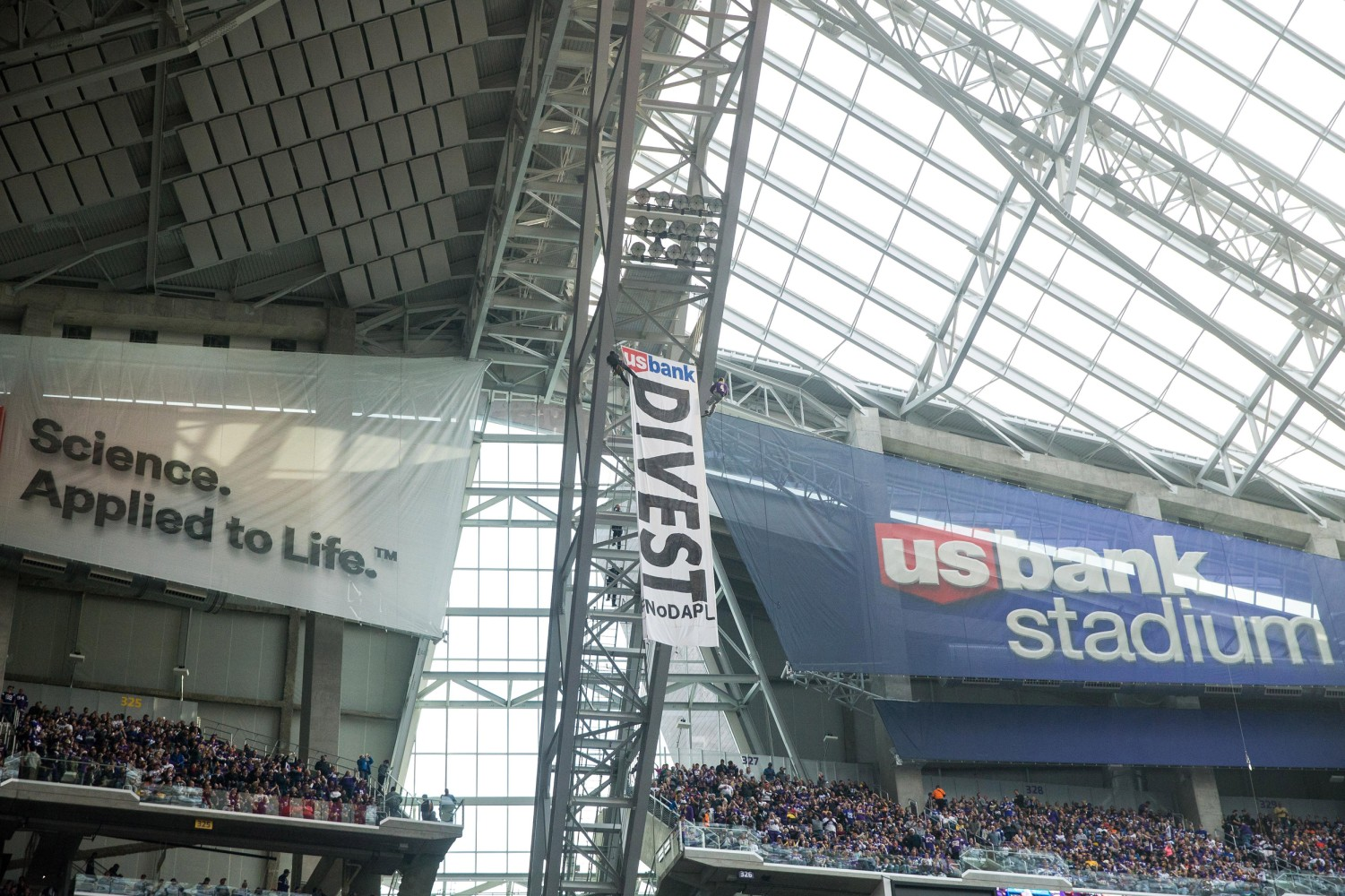 Protestors hang Dakota Access Pipeline banner at Vikings' game