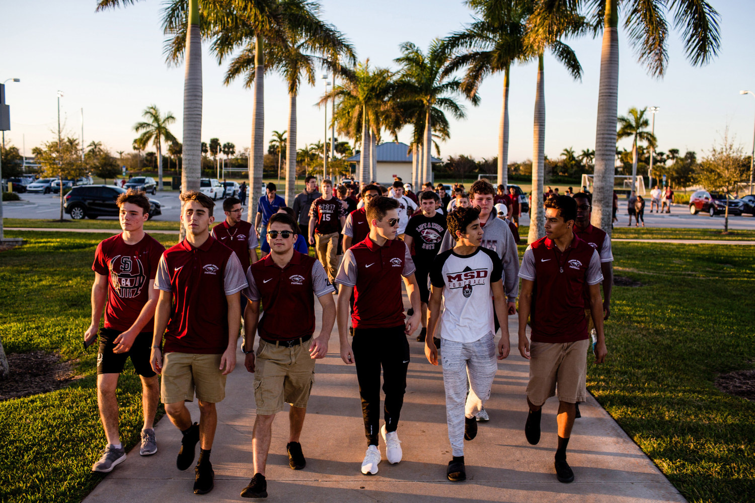 Members of the football team at Marjory Stoneman Douglas High School walk together before a vigil to honor victims of the mass shooting at their school in Parkland, Florida on Feb. 15, 2018. Saul Martinez / Redux Pictures