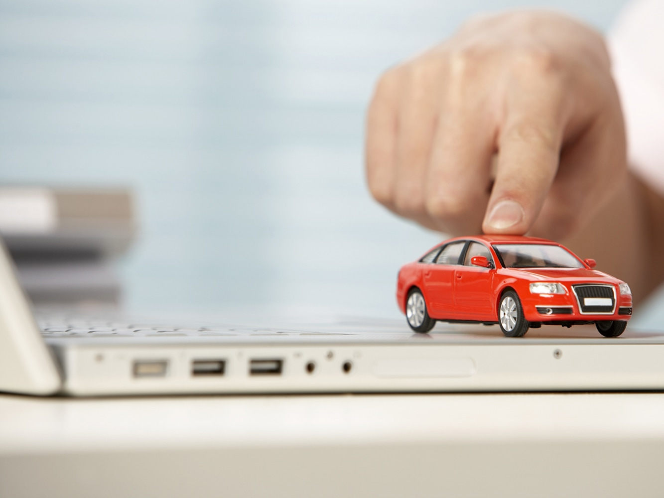 10 10 tips for car buying - A Businessman Playing With A Toy Car At His Desk
