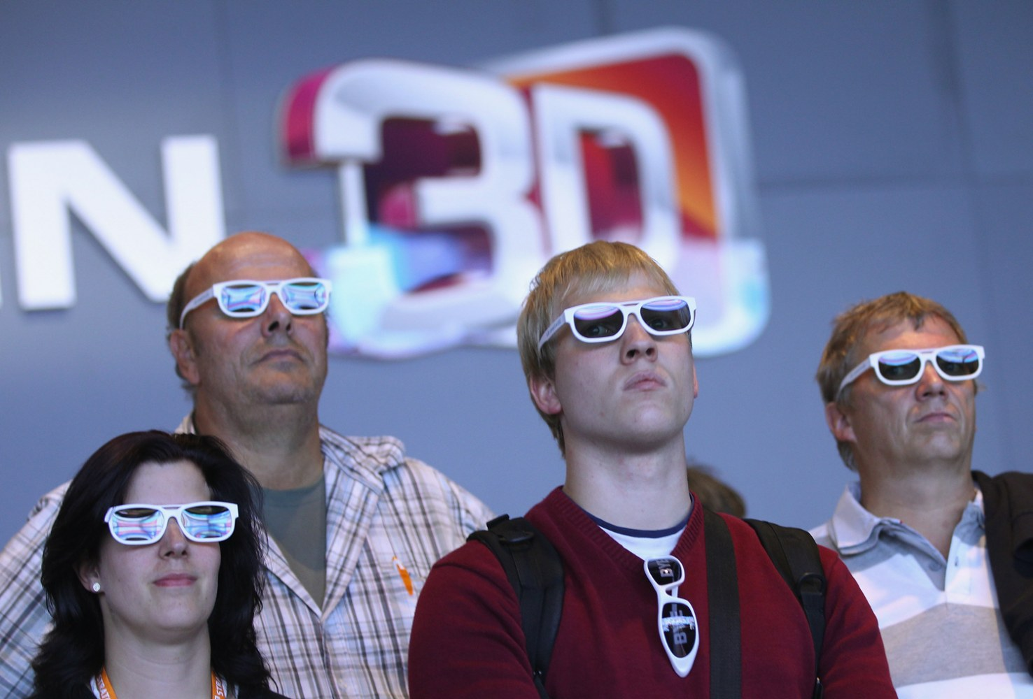 21775c918b0 Visitors wear 3D glasses while watching a presentation of 3D Smart TV at  the LG stand