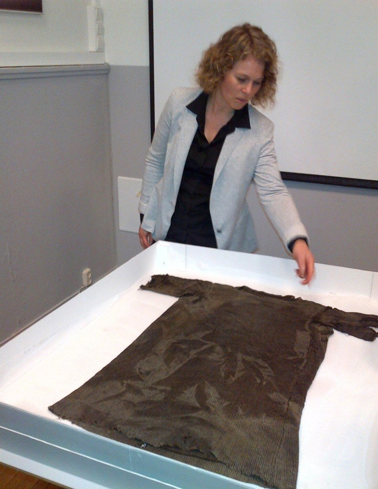 Pre viking tunic found on glacier as warming trend aids for 1700 feet to meters
