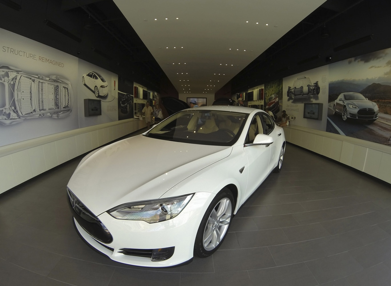 A Tesla Model S Electric Car Is On Display At In Ping