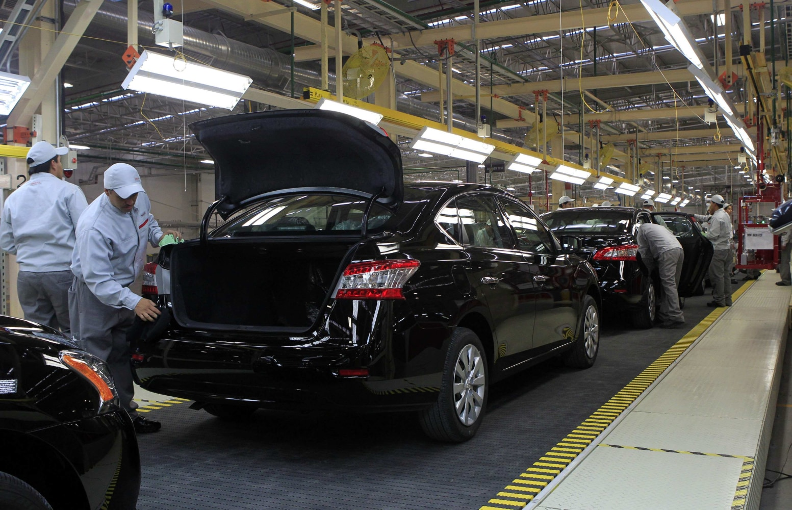 Mexican city gears up as new motor city nbc news for Motor city assembly line