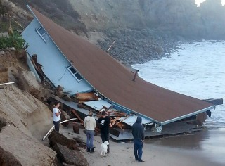 Image: The destroyed lifeguard building rests on the beach at Sycamore Cove in Point Mugu State Park, Calif.
