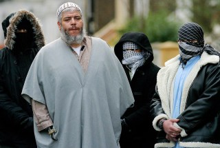Image: Abu Hamza surrounded by supporters outside the Finsbury Park Mosque on Feb. 7, 2003