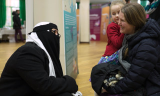 "Image: A volunteer speaks to visitors on ""Visit My Mosque Day"" at Finsbury Park Mosque in north London."