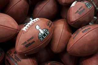 Image: Footballs sit inside of a bin waiting to be inspected before they are shipped inside of the Wilson Sporting Goods Football Factory in Ada, Ohio