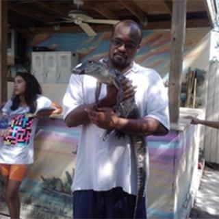 Image: Jermaine McBean with an alligator