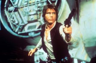 Harrison Ford drawing a gun
