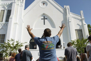 Image: People listen to the Sunday service outside the Emanuel AME Church