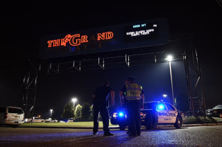 Image: Lafayette police stand outside of the Grand Theatre on Thursday