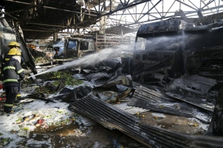 Image: Firefighters at scene of blast in Baghdad market