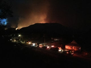 Image: Fires light up the night sky over Twisp, Washington, where three firefighters died late Wednesday.