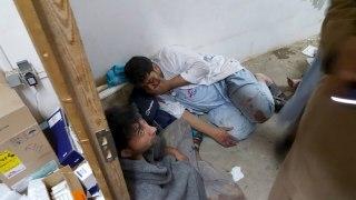 Image: Afghan staff react inside an MSF hospital in Kunduz