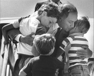 Image: File photo of Canada's Prime Minister Pierre Trudeau greeting his sons Justin, Sacha and Michel after returning home from a foreign trip in Ottawa