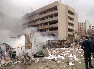 Image: Damaged cars and debris cover the ground outside the U.S. Embassy in Nairobi in 1998