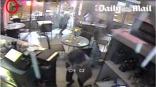 Image: Still from surveillance video showing terrorist attack on Paris restaurant