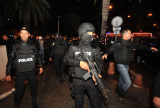 Image: Tunisian police block the road leading to the site of an explosion