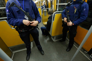 Image: Armed Belgian police patrol inside a subway train in Brussels