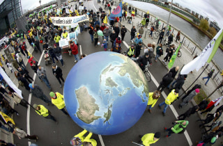 Image: Protesters demonstrate during a rally held the day before the start of the Paris Climate Change Summit in Berlin