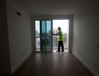 Image: A worker in an apartment unit at the Rio 2016 Athletes Village