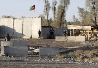 Image: Afghan security forces at the entrance gate of Kandahar Airport